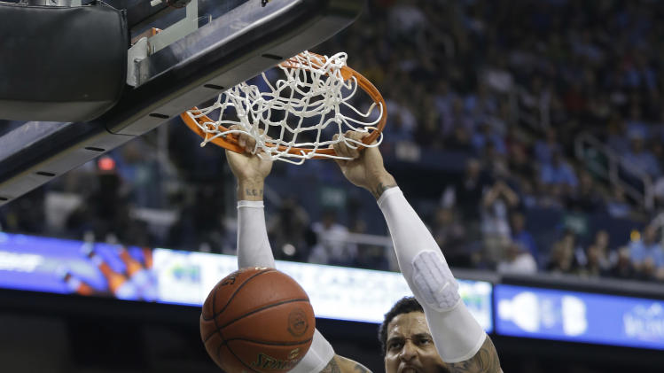 Miami's Julian Gamble (45) dunks against North Carolina during the second half of an NCAA college basketball game in the championship of the Atlantic Coast Conference tournament in Greensboro, N.C., Sunday, March 17, 2013. (AP Photo/Gerry Broome)