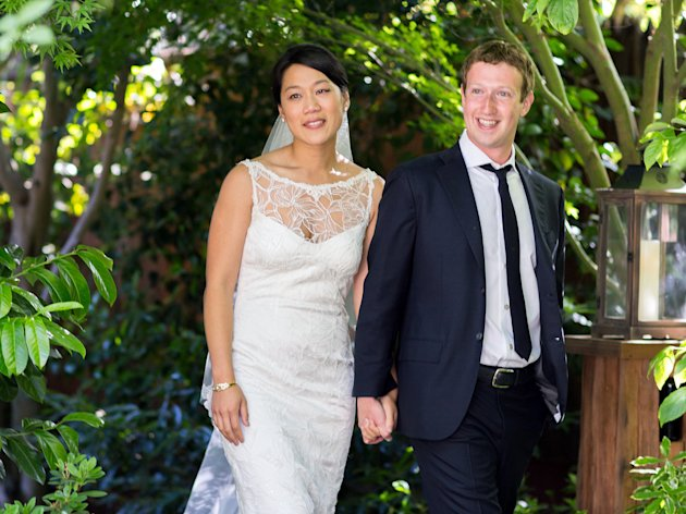 This photo provided by Facebook shows Facebook founder and CEO Mark Zuckerberg and Priscilla Chan at their wedding ceremony in Palo Alto, Calif., Saturday, May 19, 2012. Zuckerberg updated his status to &quot;married&quot; on Saturday. The ceremony took place in Zuckerberg&#39;s backyard before fewer than 100 guests, who all thought they were there to celebrate Chan&#39;s graduation. (AP Photo/Facebook, Allyson Magda Photography)