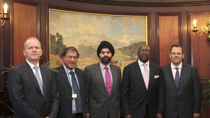 IMAGE DISTRIBUTED FOR MASTERCARD WORLDWIDE – Michael Miebach, President, Middle East and Africa, MasterCard Worldwide (left), Ismail Momoniat, Head: Tax and Financial Sector Policy (second from left), Ajay Banga, MasterCard Worldwide President and CEO (centre), South Africa's Deputy Minister of Finance Nhlanhla Nene (second from right) and Philip Panaino, Division President, South Africa for MasterCard Worldwide (far right) met to discuss the importance of the financial sector and Government in working together to ensure financial inclusion for all South Africans in Pretoria on Thursday, Jan. 17, 2013. According to the FinScope South Africa 2012 study, 67% of the South African population aged 16 and above is banked, with this figure expected to reach 70% in 2013, thanks to the country's new social grant disbursement system introduced in March 2012. This system sees social grant beneficiaries being issued with South African Social Security Agency (SASSA) Debit MasterCard cards. By the first half of 2013, an estimated 10 million South Africans - nearly one-fifth of the country's population - will be able to take advantage of the convenience and added security benefits offered by the new SASSA card. (Nadine Hutton/AP Images for MasterCard Worldwide)
