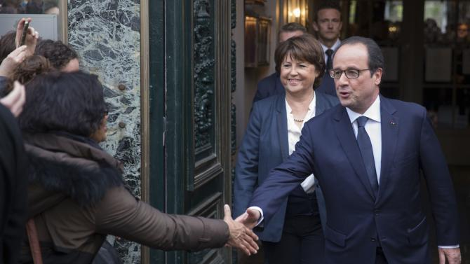 Lille's Mayor Martine Aubry and French President Francois Hollande leave a restaurant after a lunch in the city centre in Lille