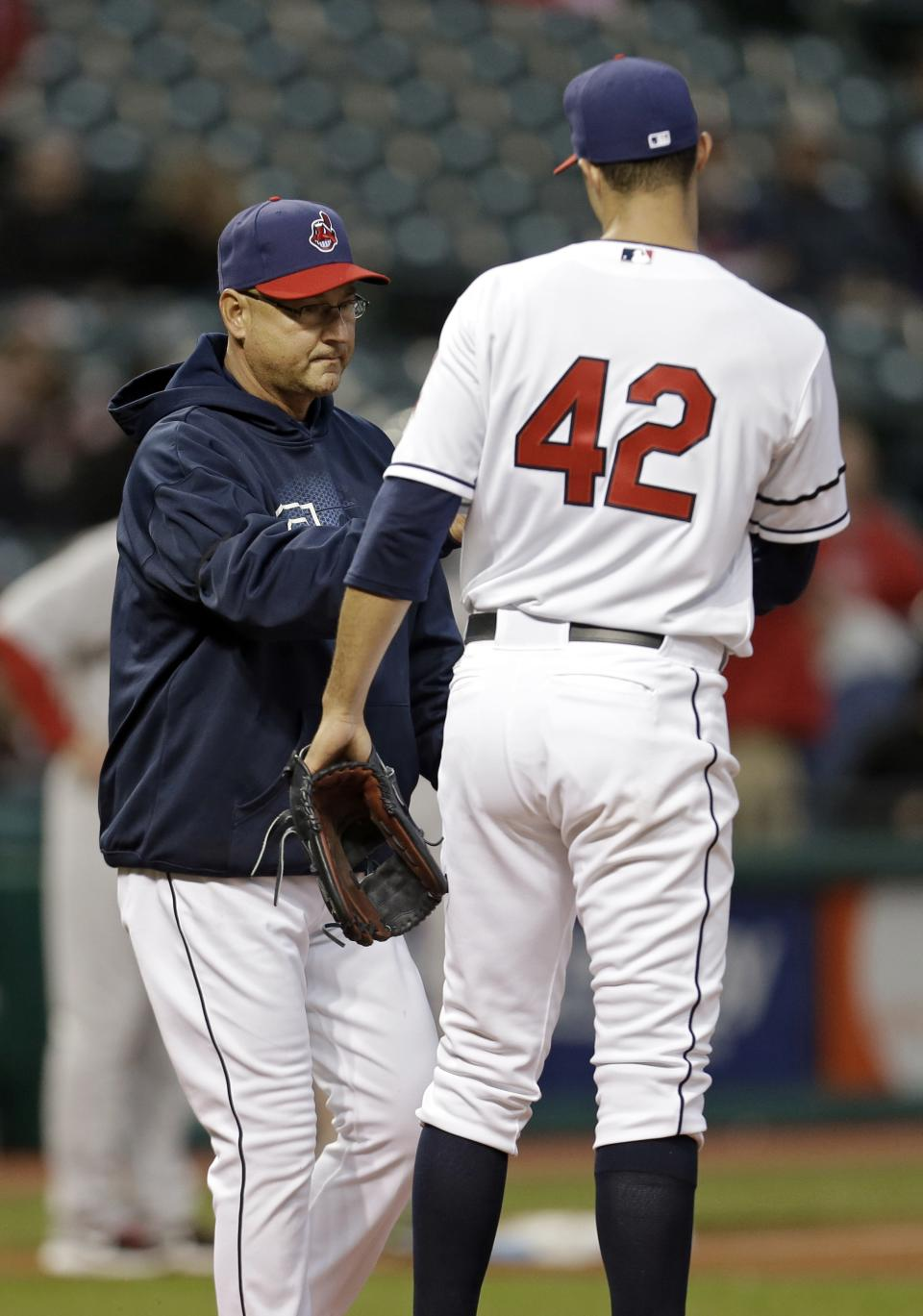 Cleveland Indians manager Terry Francona, left, takes starting pitcher Ubaldo Jimenez out of a baseball game against the Boston Red Sox in the second inning Tuesday, April 16, 2013, in Cleveland. (AP Photo/Mark Duncan)