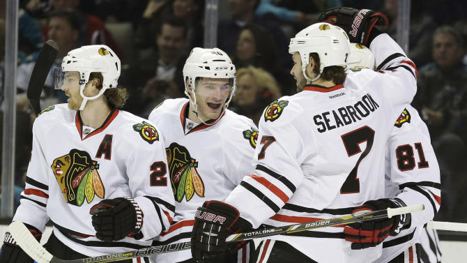 Chicago Blackhawks left wing Brandon Saad, second from left, celebrates with teammates after scoring against the San Jose Sharks during the first period of an NHL hockey game in San Jose, Calif., Tuesday, Feb. 5, 2013. (AP Photo/Marcio Jose Sanchez)