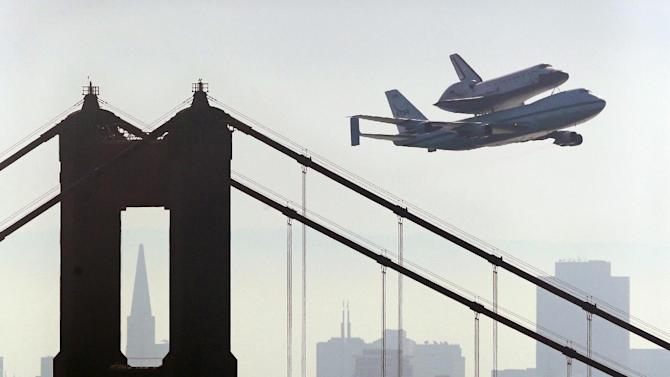 Space Shuttle Endeavour mounted on NASA's Shuttle Carrier Aircraft,  passes over the Golden Gate Bridge in San Francisco,  Friday, Sept. 21, 2012.  Endeavour is making a final trek across the country to the California Science Center in Los Angeles, where it will be permanently displayed. (AP Photo/Marcio Jose Sanchez)