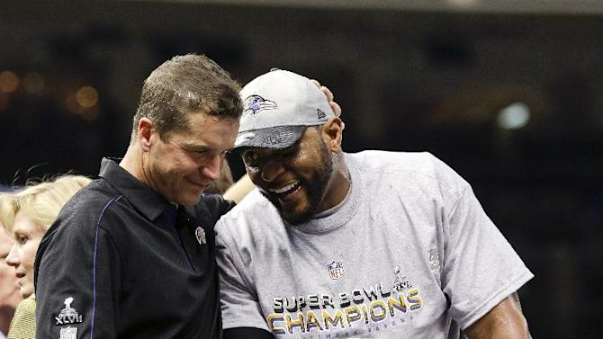 Baltimore Ravens linebacker Ray Lewis, right, and head coach John Harbaugh celebrate after their 34-31 win against the San Francisco 49ers in the NFL Super Bowl XLVII football game, Sunday, Feb. 3, 2013, in New Orleans. (AP Photo/Dave Martin)