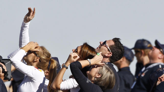 Felix Baumgartner's mother Ava Baumgartner, middle, watches with other family members and friends as his capsule lifts off as he attempts to break the speed of sound with his own body by jumping from a space capsule lifted by a helium balloon, Sunday, Oct. 14, 2012, in Roswell, N.M.  Baumgartner plans to jump from an altitude of 120,000 feet, an altitude chosen to enable him to achieve Mach 1 in free fall, which would deliver scientific data to the aerospace community about human survival from high altitudes.(AP Photo/Ross D. Franklin)
