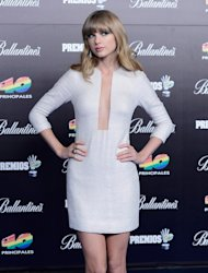 Taylor Swift flashes the flesh with white mini dress in Madrid