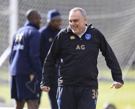 Portsmouth manager Avram Grant reacts during a team training session at their training ground in Southampton
