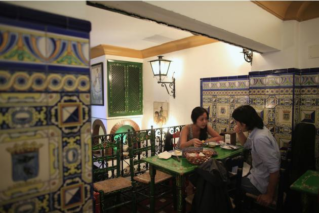 Japanese flamenco students Maika Kubo and Akihiro Kawahata talk in a restaurant in Seville