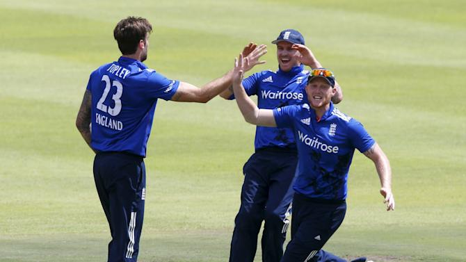 England's Topley, Roy and Stokes celebrate the wicket of South Africa's Rossouw during the One Day International Cricket match in Cape Town