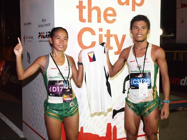 Mary Joy Tabal and John Philip - winners of the Sundown Marathon 21km Category. (Photo courtesy of HiVelocity Events)