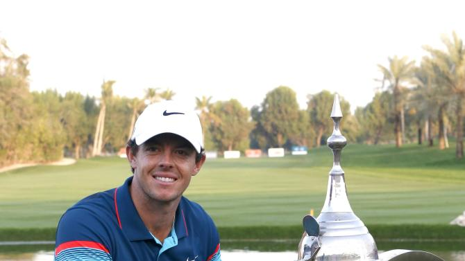 Rory McIlroy of Northern Ireland poses with the winners trophy after the final round of the Dubai Desert Classic