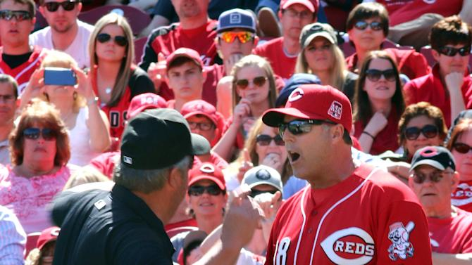 FILE - In this Sunday, April 12, 2015, file photo, Cincinnati Reds manager Bryan Price is ejected by umpire Joe West while arguing a call against the St. Louis Cardinals in the seventh inning of a baseball game, in Cincinnati. Price went on a profanity-filled rant during his pregame meeting with media, Monday, April 20, 2015, taking exception with the way his team was being covered. (AP Photo/Tom Uhlman, File)