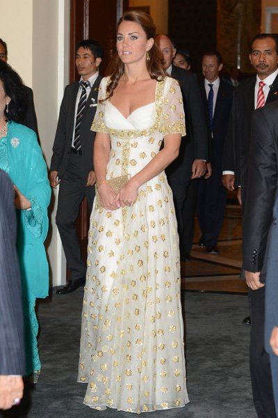 Kate wears a dress fit for a queen at the official dinner hosted by Malaysia's Head of State Sultan Abdul Halim Mu'adzam Shah of Kedah on Day 3 of her and Prince William's Diamond Jubilee Tour of Sout