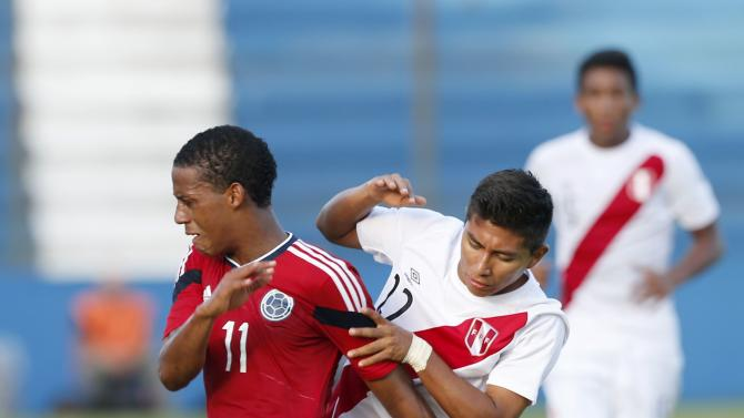 Colombia's Jeison Lucumi and Peru's Miguel Carranza compete for the ball during their match for the final round of the South American Under-20 Championship in Montevideo