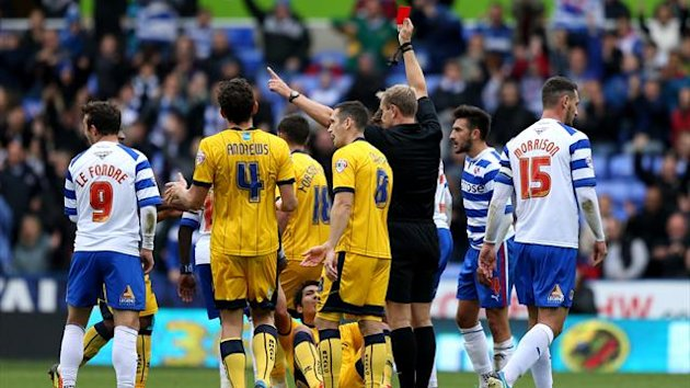 Referee Mr G. Scott shows a red card to Brighton & Hove Albion's Leonardo Ulloa (on floor)