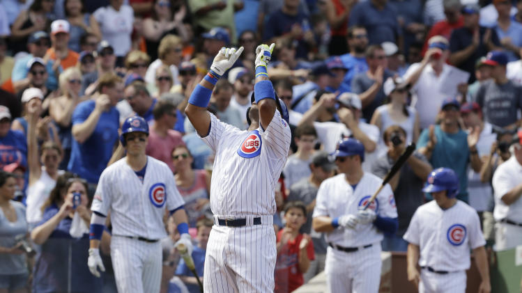Chicago Cubs' Luis Valbuena (24) looks up as he celebrates after hitting a solo home run against the Baltimore Orioles during the fourth inning of an interleague baseball game in Chicago, Friday, Aug. 22, 2014. (AP Photo/Nam Y. Huh)