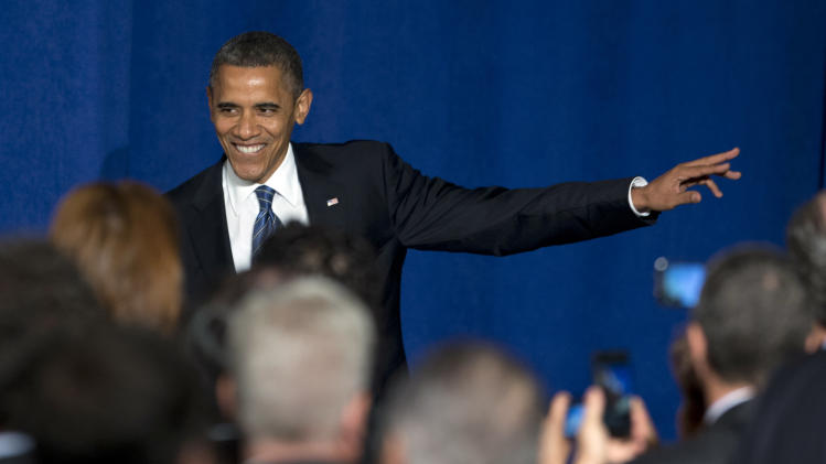 President Barack Obama arrives at a campaign fundraiser at the JW Marriott Marquis Miami, Thursday, Oct. 11, 2012, in Miami. (AP Photo/Carolyn Kaster)