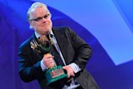 US actor Philip Seymour Hoffman holds the Coppa Volpi for the Best Actor he received with US actor Joaquin Phoenix for &quot;The Master&quot; during the award ceremony of the 69th Venice Film Festival