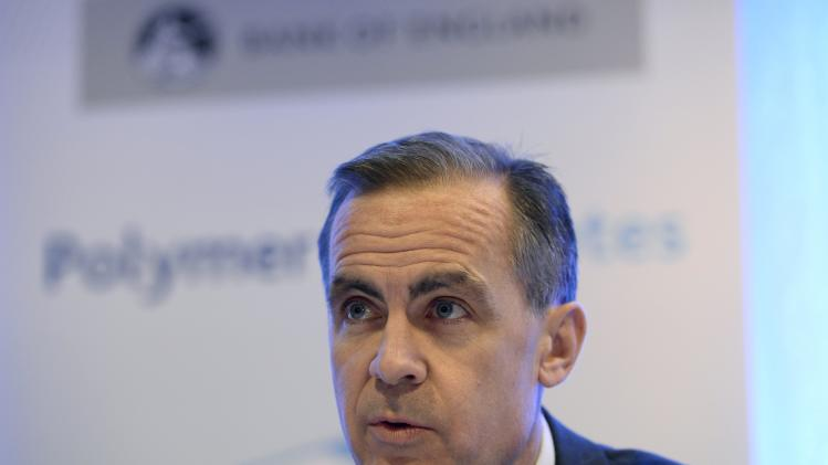 The Governor of Britain's Bank of England, Mark Carney, speaks at a news conference at the Bank of England, in the City of London