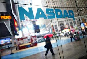 File of pedestrians walk past the NASDAQ MarketSite in New York's Times Square