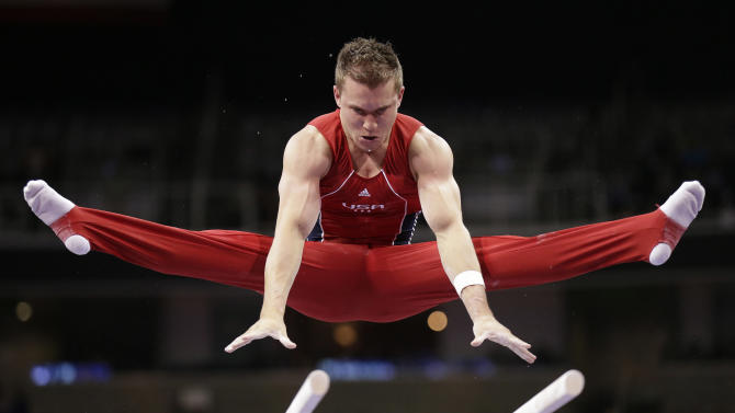 Jonathan Horton competes on the parallel bars during the final round of the men's Olympic gymnastics trials, Saturday, June 30, 2012, in San Jose, Calif. (AP Photo/Gregory Bull)