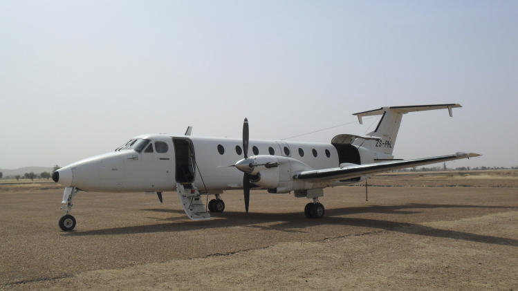 In this March 2013 photo taken by pilot Rene Joubert and released by the family of Jerry Krause, the twin-engine Beechcraft 1900C aircraft that Krause was flying when he disappeared on April 7, 2013, is shown parked at an unidentified location. Ten days ago, on April 7, Krause disappeared together with his plane just miles from a refueling stop at a West African island in the middle of a tropical storm of thunder and lightning. Since then, searches with a plane and boats have found no trace of Krause, a 54-year-old American missionary and pilot, or the plane that he was flying from South Africa to Mali. Family members say that the plane had been refurbished and the exterior repainted in early April in South Africa. (AP Photo/Rene Joubert) MANDATORY CREDIT