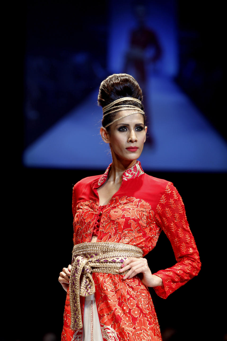 An Indian model displays a creation by Krishna Mehta during the Lakme Fashion Week in Mumbai, India, Sunday, Aug. 5, 2012. (AP Photo/Rafiq Maqbool)