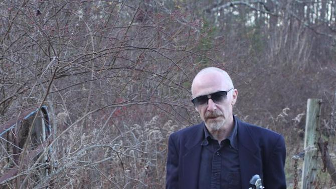 This 2009 publicity photo provided by Shore Fire shows musician Graham Parker near New Paltz, New York. (AP Photo/Shore Fire, Jeff Fasano)