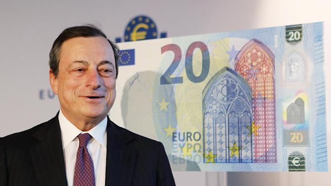 FILE - This is a Tuesday, Feb. 24, 2015 file photo of President of European Central Bank Mario Draghi as he stands next to a facsimile of the new 20 euro banknote in Frankfurt, Germany. More and more, Europe's economy is showing signs of life. Now if only this Greek thing would clear up. That, in a nutshell, is the situation European Central Bank head Mario Draghi faces as the bank's top officials head into their meeting Wednesday June 3, 2015.(AP Photo/Michael Probst, File)
