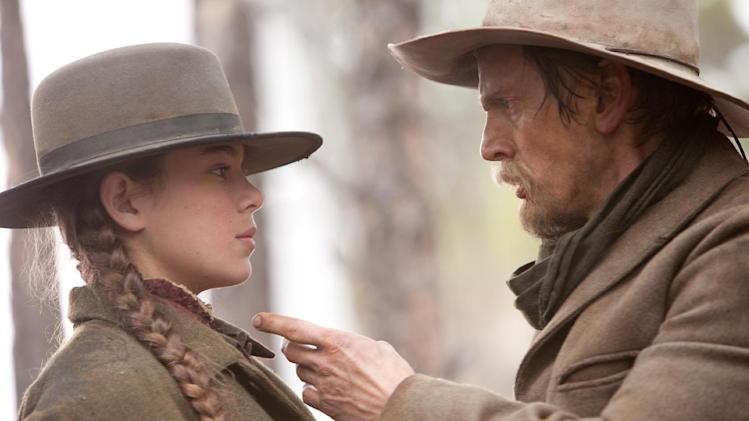 "MOVES TUES., JULY 3, 2012 CHRISTY LEMIRE - FILE - In this film publicity image released by Paramount Pictures, Hailee Steinfeld, left, and Barry Pepper are shown in a scene from, ""True Grit."" (AP Photo/Paramount Pictures, Lorey Sebastian)"