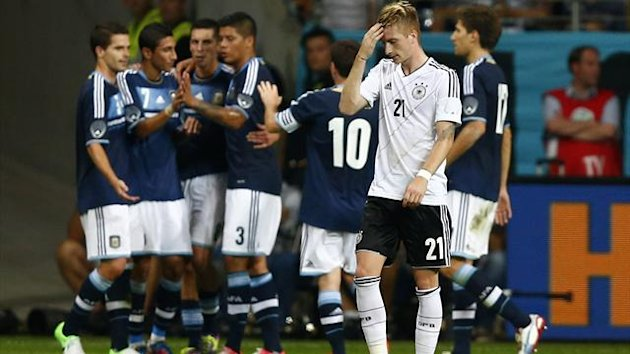 Germany's Marco Reus (21) reacts after Argentina scored its first goal during their friendly match in Frankfurt August 15, 2012.