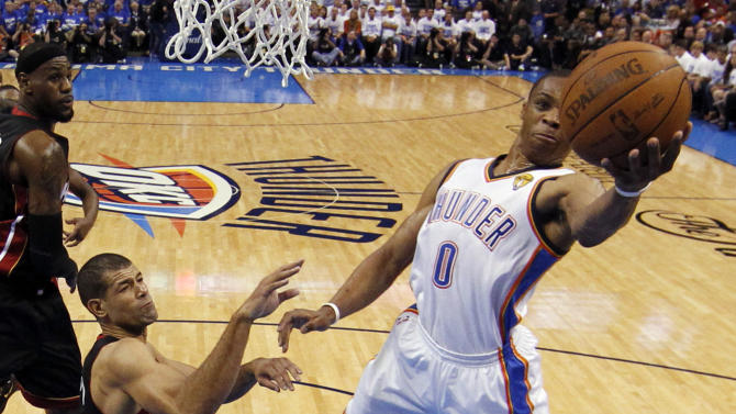 Oklahoma City Thunder point guard Russell Westbrook (0) shoots around Miami Heat small forward Shane Battier during the first half at Game 2 of the NBA finals basketball series, Thursday, June 14, 2012, in Oklahoma City. (AP Photo/Jim Young, Pool)