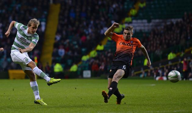Dundee United's Paton challenges Celtic's Pukki during Scottish Premier League in Glasgow, Scotland
