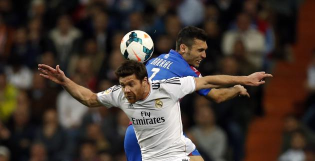 Real Madrid's Alonso and Levante's Barral fight for the ball during their Spanish first division soccer match in Madrid