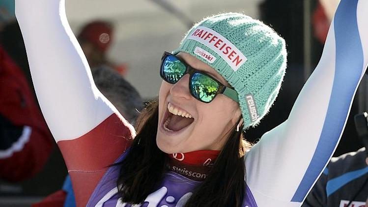 Switzerland's Marianne Kauffmann-Abderhalden celebrates after winning the women's downhill race at the Alpine Skiing World Cup in Val d'Isere, France on December 21, 2013