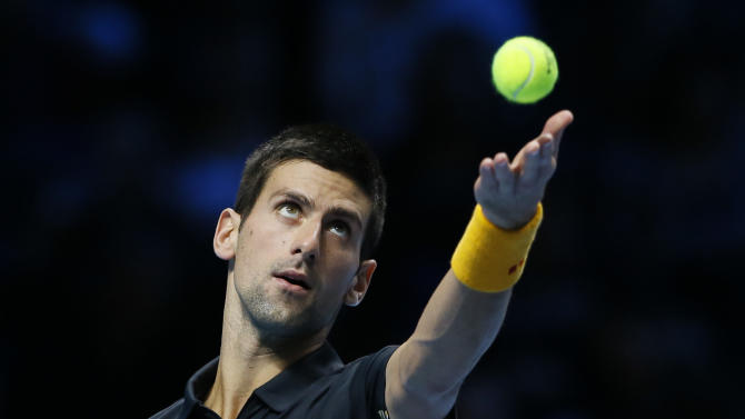 Novak Djokovic of Serbia serves to Tomas Berdych of Czech Republic during their ATP World Tour Finals singles tennis match at the O2 Arena in London, Friday, Nov. 9, 2012. (AP Photo/Kirsty Wigglesworth)
