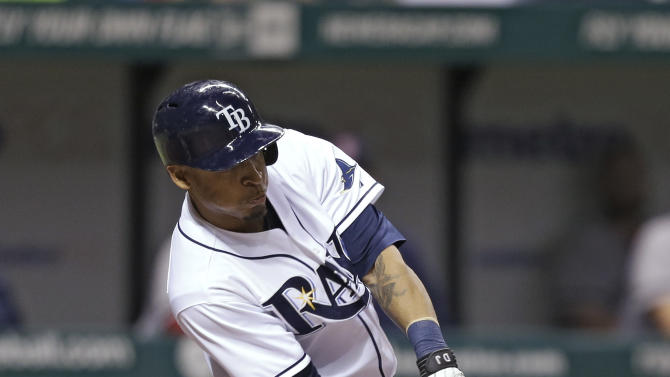 Tampa Bay Rays' Desmond Jennings lines a sixth-inning RBI single off Boston Red Sox relief pitcher Clayton Mortensen during a baseball game Thursday, May 16, 2013, in St. Petersburg, Fla. Matt Joyce scored on the hit. (AP Photo/Chris O'Meara)
