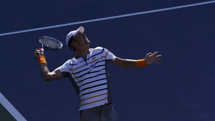 Tomas Berdych of the Czech Republic serves to Martin Klizan of Slovakia during their match at the 2014 U.S. Open tennis tournament in New York
