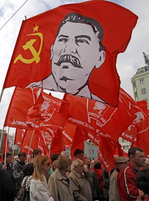 FILE - In this May 1, 2012 file photo, Communist Party supporters march with their flags during a rally to mark May Day in Moscow, Russia. The southern Russian city where the Red Army decisively turned back Nazi forces in a key World War II battle will once again be known as Stalingrad, at least on the days commemorating the victory.The city was renamed Volgograd in 1961 as part of the Soviet Union's rejection of dictator Joseph Stalin's personality cult. But the name Stalingrad is inseparable with the battle, in which at least 1.25 million people died. Russia on Saturday plans extensive ceremonies to mark the 70th anniversary of the battle's end. (AP Photo/Mikhail Metzel, File)