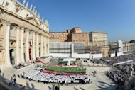 "Pope Benedict XVI (on the altar) leads a mass to announce a new global ""Year of Faith"" at St. Peter's Square. The Vatican is celebrating the 50th anniversary of a Council that changed the face of Catholicism, as it tries to rekindle the religious fervour of the time amid rising secularism"