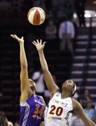 Seattle Storm's Camille Little (20) tips off against Phoenix Mercury's Krystal Thomas in the first half of a WNBA basketball game, Thursday, Aug. 16, 2012, in Seattle. (AP Photo/Elaine Thompson)