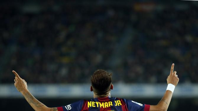 Barcelona's Neymar celebrates a goal against Sevilla during their Spanish first division soccer match at Camp Nou stadium in Barcelona