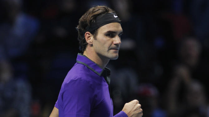 Roger Federer of Switzerland reacts to his set win against Andy Murray of Britain during their ATP World Tour Finals singles semifinal tennis match at the O2 Arena in London, Sunday, Nov. 11, 2012. (AP Photo/Sang Tan)