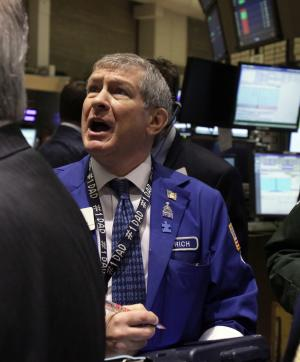 In a May 7, 2012 photo trader Richard Newman works on the floor of the New York Stock Exchange.  A weekend summit in Washington among leaders of the world's most powerful nations provided little in the way of encouragement for investors already nervous about the political turmoil in Greece.   (AP Photo/Richard Drew)