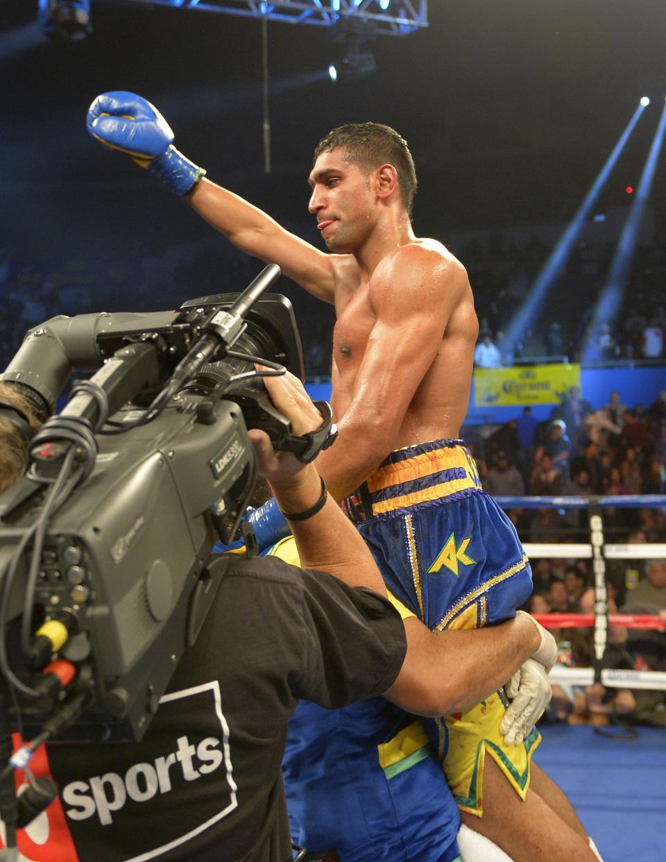 Amir Khan of Great Britain celebrates ofter winning his fight over Carlos Molina during their WBC silver super lightweight title bout, Saturday, Dec. 15, 2012, in Los Angeles.  (AP Photo/Mark J. Terrill)