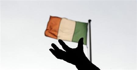 Ireland's national flag flies above a statue on O'Connell Street in Dublin December 5, 2011. REUTERS/Cathal McNaughton