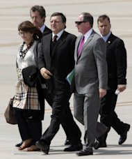 "European Commission President Jose Manuel Barroso (C) arrives in the US for the G8 summit. ""We need to take action for growth while staying the course in terms of putting our public finances in order. Stability and growth go together, they are two sides of the same coin,"" Barroso said"