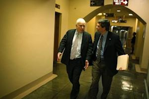 McCain and Begich depart together after the Senate passed a spending bill to avoid a government shutdown, sending the issue back to the House of Representatives, at the U.S. Capitol in Washington
