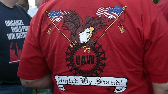 A United Auto Workers union member wears a shirt during a ceremony commemorating the Battle of the OverPass in Dearborn