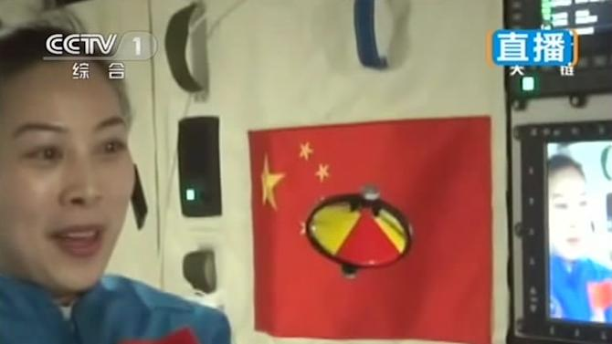 In this image taken June 20, 2013 and made from tv via Xinhua News Agency, female astronaut Wang Yaping, of Shenzhou 10 spacecraft, demonstrates gyroscopic motion in space during a lecture to students on Earth, aboard China's space module Tiangong 1. China's astronauts spun gyroscopes and implanted tiny knots into sheets of suspended water during their first classroom lecture from the country's orbiting space station, part of efforts to popularize the successful manned space flight program among young people.(AP Photo/CCTV via Xinhua) NO SALES